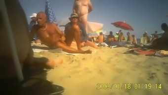 Milf touching husband's dick in public seaside