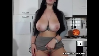fascinating big boobs camgirl exhibits it all and masturbates on cam