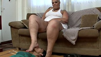 Huge bad fats brown milf along with a foot thing gets pleasured