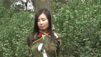 Oriental military girl connected to bush first