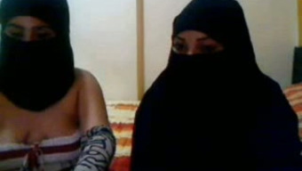 Twisted Arab nymphos in hijab appreciate soliciting on webcam to my delight