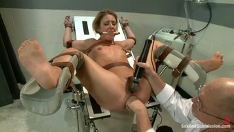 Held captive blonde gets busy and fucked using a physician