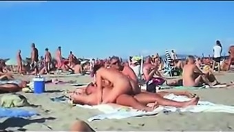 cuckolding within a topless beach gets reported