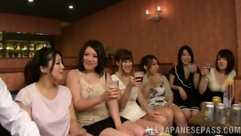 At a community a grouping of Japanese females has sector intercourse with strange guys
