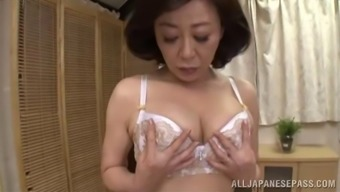 Fathers should sperm very consequently this Oriental MILF brushes her pussy
