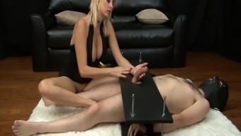 Mean MILF gives mean femdom handjob to really junk in servitude