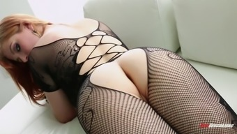 Redheaded in fishnet stockings interests deepthroating and hardcore fisting