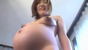 From asia preggo performs together tits