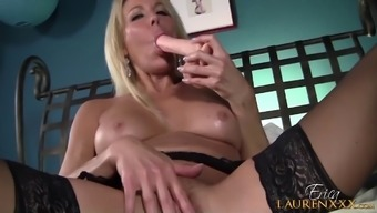 Age hooker Erica Lauren take pleasure in poking her polished pussy by using a dildo