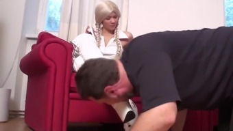 Dominant Ladies order slaves to lick their boots clean