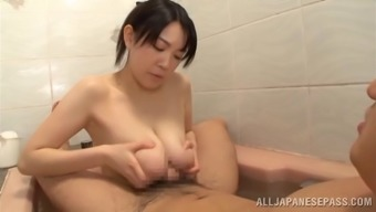 Complex Asian bimbo loving her great bubbly titties being stroked smoothly under the shower