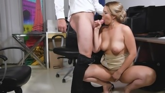 Busty milf sucks the new guy at the office