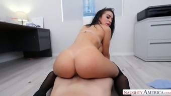 After blowing cock in the office curvy Victoria June rides dick on top