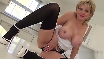 Unfaithful English milf lady Sonia presents her massive hooters
