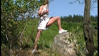 Horn-mad village young chick exposes her sexy thighs while peeing outdoors