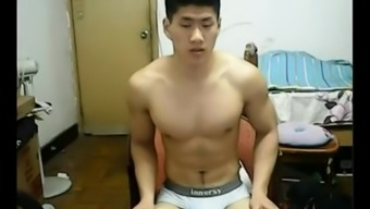 Beefy Oriental chunk leaves base his clothing and bad boys off his cock on web camera.