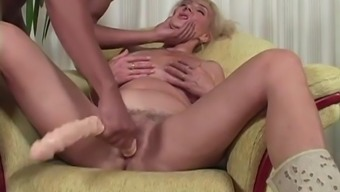 Big tits age woman along with a black penis
