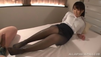 Foot fixation dame in nylon pantyhose performing her elegant teases