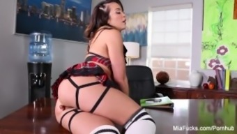 Busty brunettes Mia and London fuck on the desk